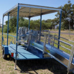 Contracting trailer for sheep handling